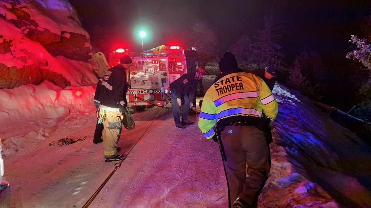A team of firefighters and troopers rescue six people from a car that went over the edge of the rugged Old Stage Road, located on the far southwest side of Colorado Springs. (Photo: Colorado Springs Fire Department)