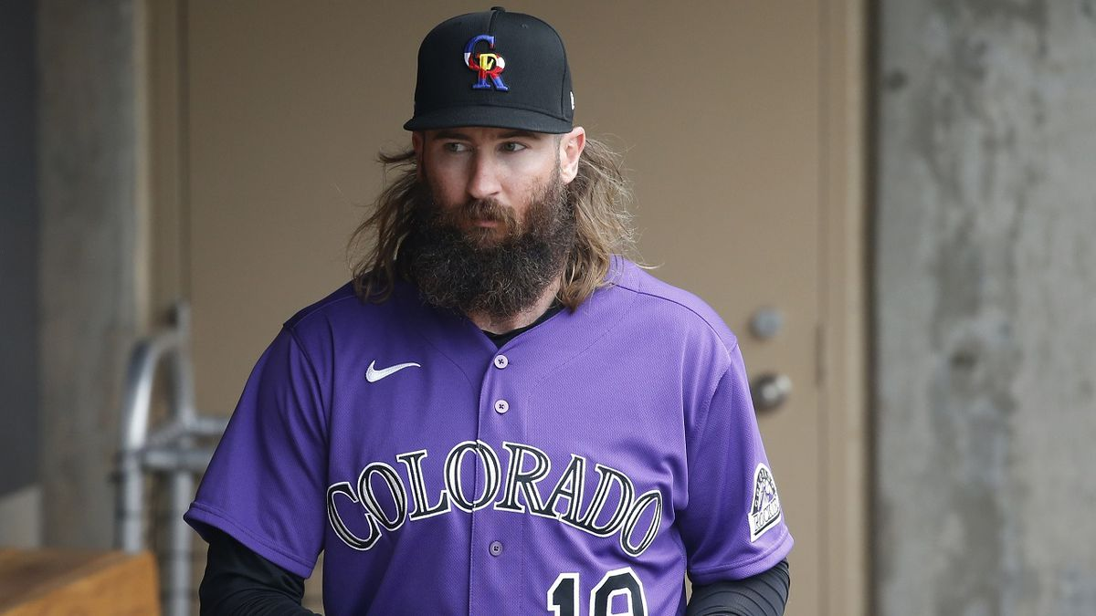 Colorado Rockies' Charlie Blackmon walks through the dugout prior to a spring training baseball game against the Cincinnati Reds Tuesday, March 10, 2020, in Scottsdale, Ariz. (AP Photo/Ross D. Franklin)