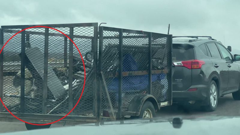 An 11 News viewer captured video of a dog appearing to struggle in an open trailer down I-25...