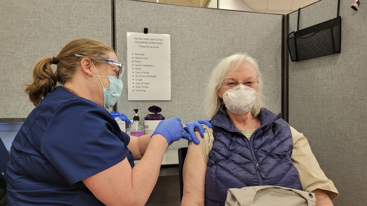 Twyla Werstein receives her COVID-19 vaccination at a UCHealth vaccine clinic in Colorado...