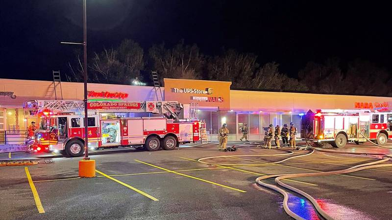 Colorado Springs firefighters outside a UPS store off Colorado and 31st Street early in the...
