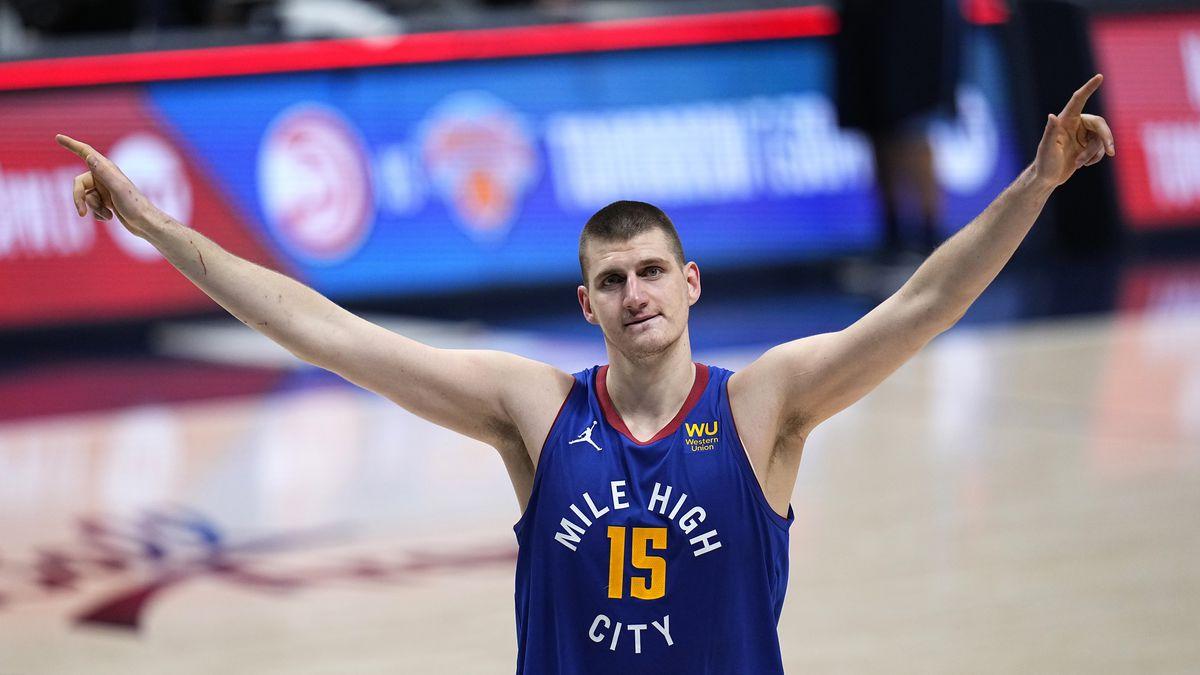Denver Nuggets center Nikola Jokic (15) celebrates the team's double-overtime win against the...