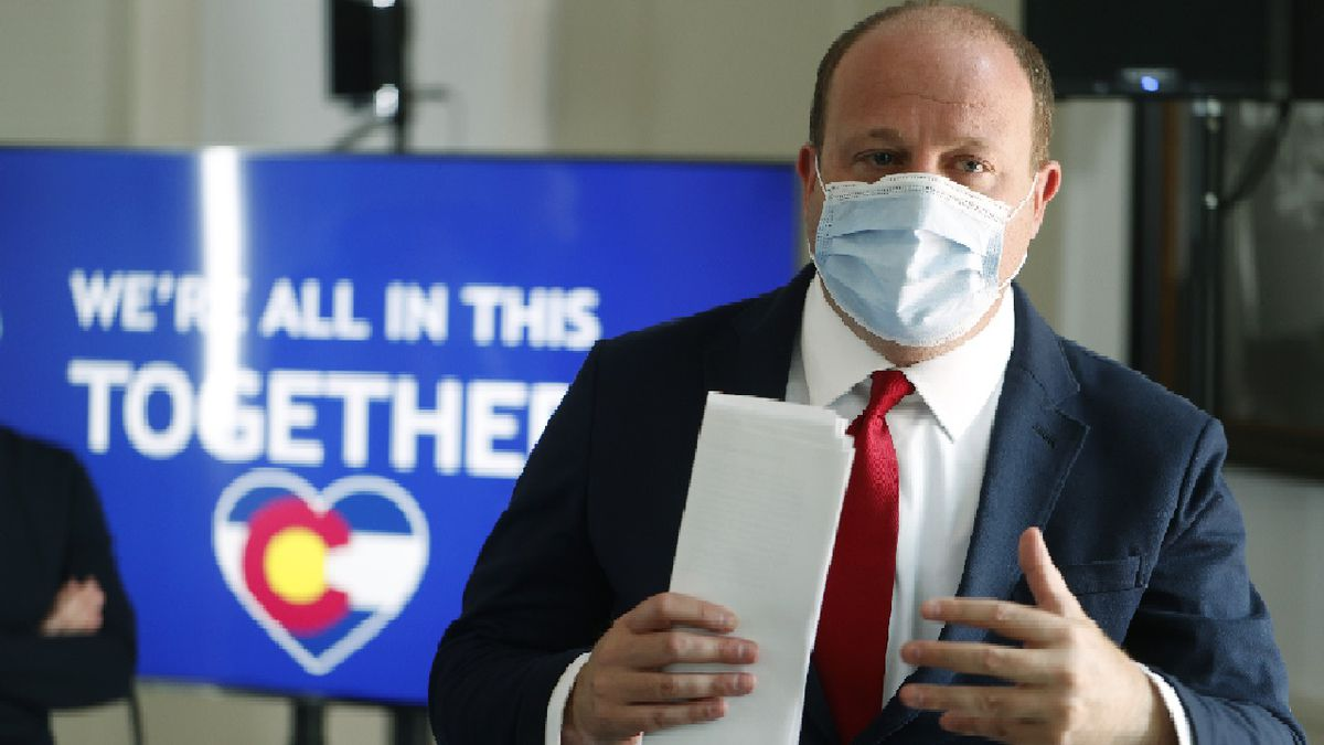 Colorado Governor Jared Polis makes a point after a news conference on the state's efforts to contain the spread of the new coronavirus Thursday, July 9, 2020, in Denver.