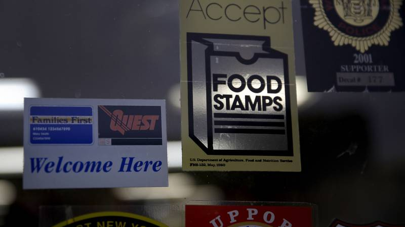In this Jan. 12, 2015 file photo, a supermarket displays stickers indicating they accept food...