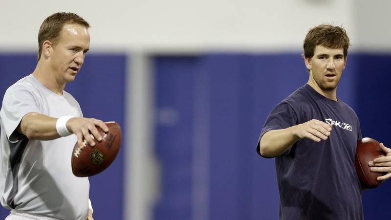 FILE - In this April 11, 2013, file photo, Denver Broncos quarterback Peyton Manning, left, and...