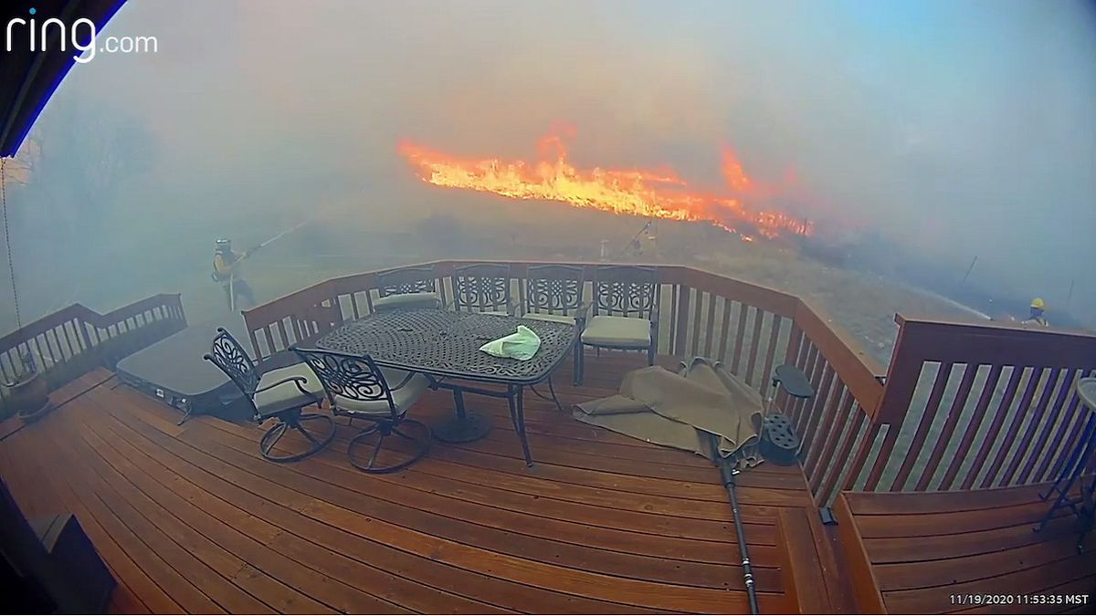 A still image taken from a Ring surveillance system showing firefighters battle the Bear Creek...