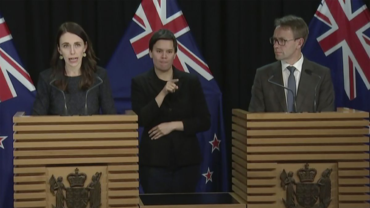 In this image from a video, New Zealand Prime Minister Jacinda Ardern, left, and...