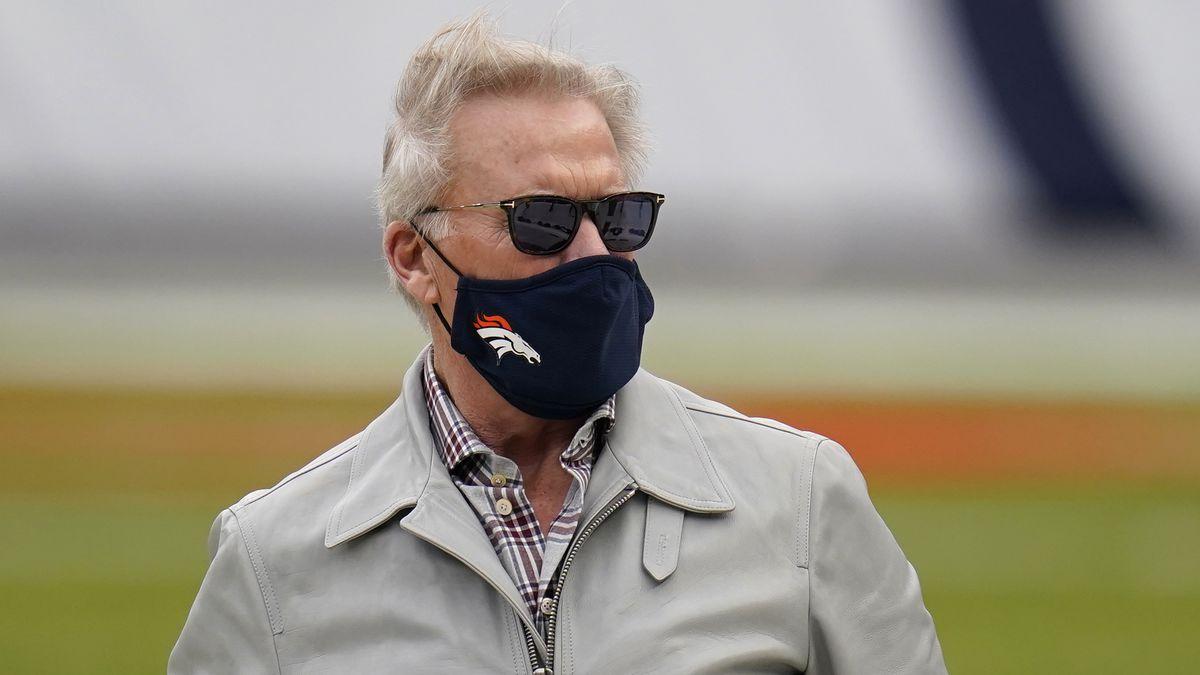 John Elway, Denver Broncos president of football operations, before an NFL football game...