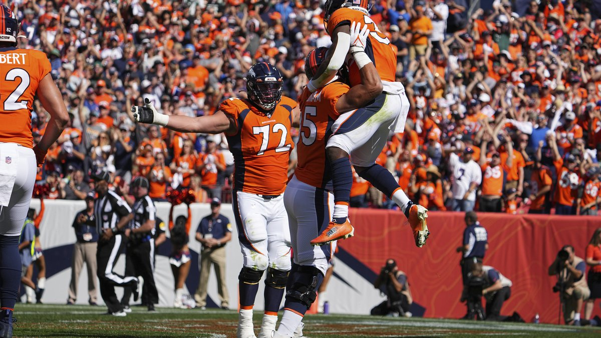 Javonte Williams of the Denver Broncos celebrates a touchdown against the New York Jets in the...