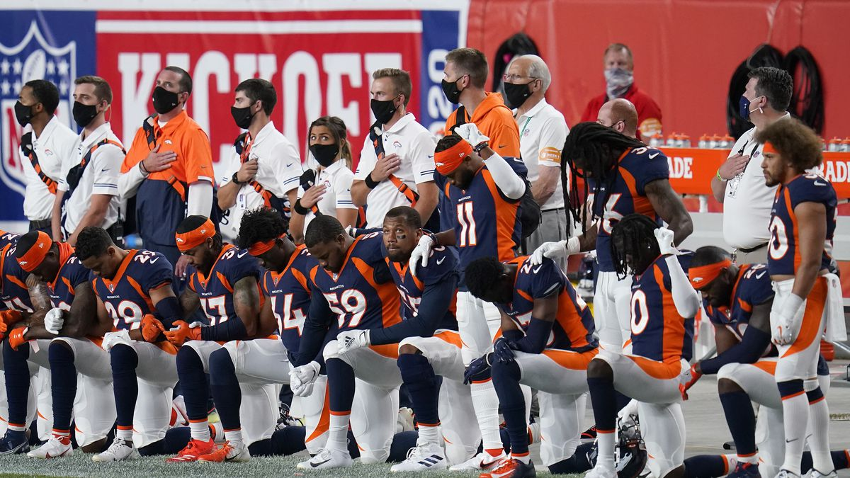 Some of the Denver Broncos kneel during the national anthem prior to an NFL football game against the Tennessee Titans, Monday, Sept. 14, 2020, in Denver.