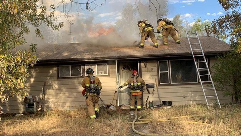 Crews fight house fire