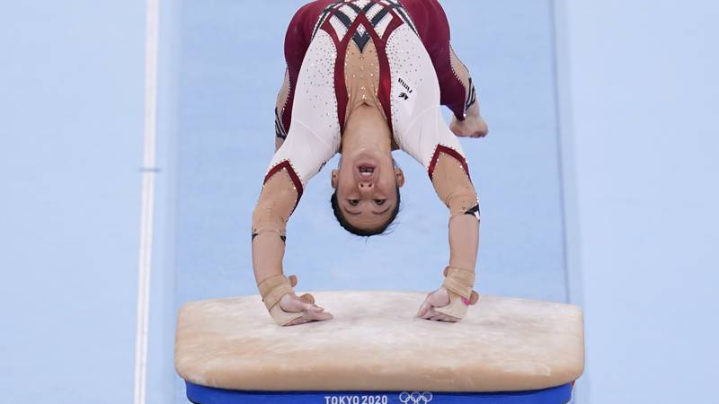 Kim Bui, of Germany, performs on the vault during the women's artistic gymnastic qualifications...
