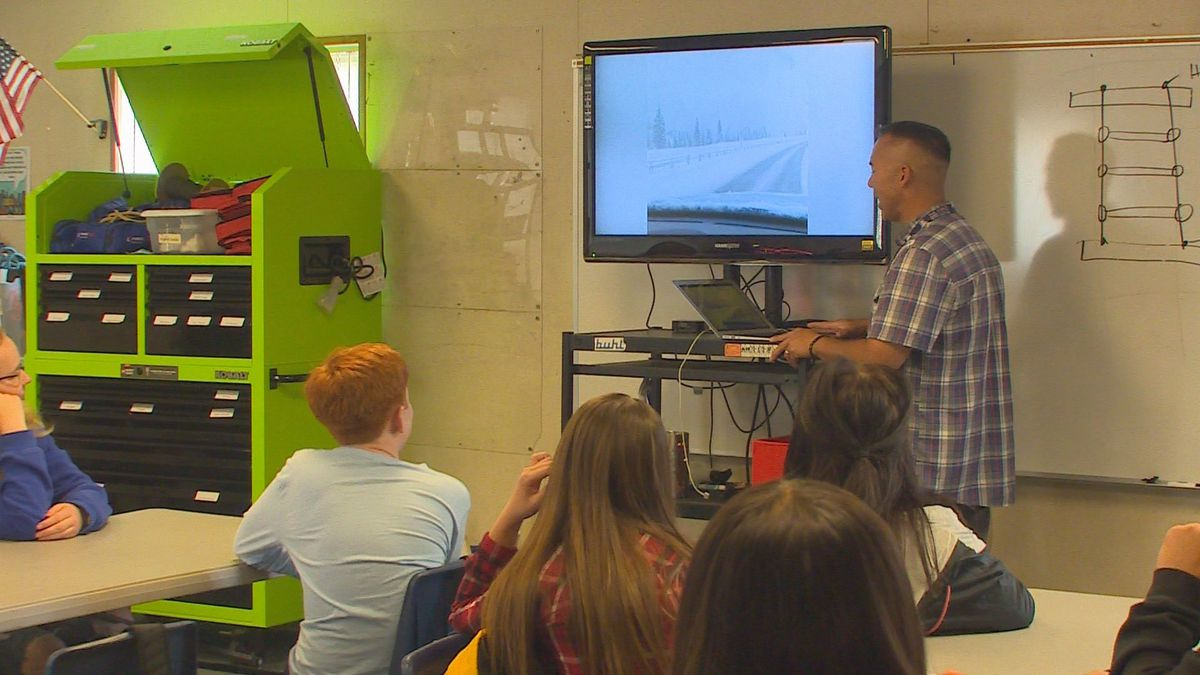 William Yerger stands in front of a group of eighth graders in his health science class at...