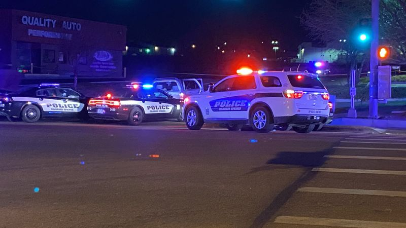 Police cars at the scene of an early morning police shooting in southeastern Colorado Springs...