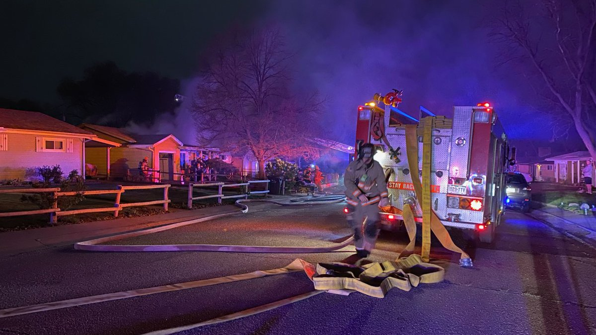 Firefighters at the scene of a house fire in Security on May 17, 2021.