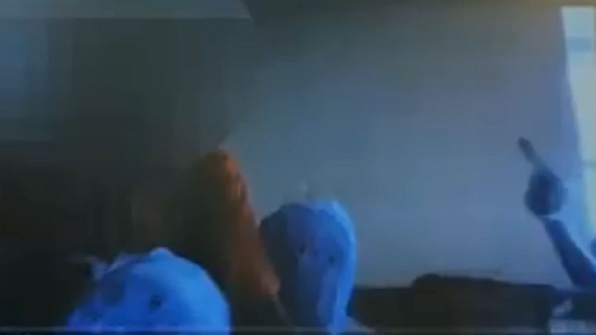 A still frame of the moment a 12-year-old waved a toy gun during an online class.