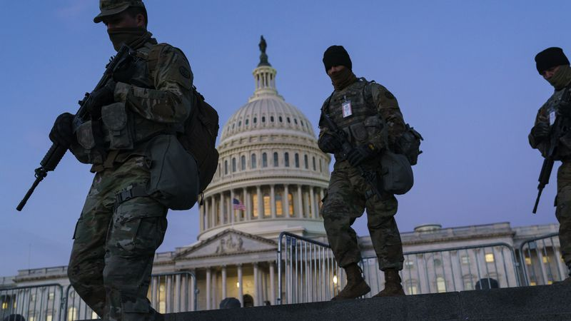 National Guard troops reinforce the security zone on Capitol Hill in Washington, Tuesday, Jan....