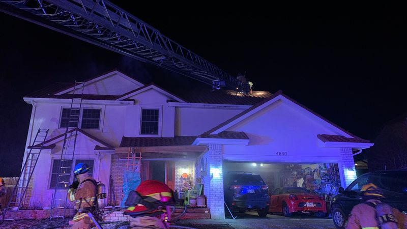 Firefighters working outside the home and on the roof on April 12, 2021.  The fire is believed...