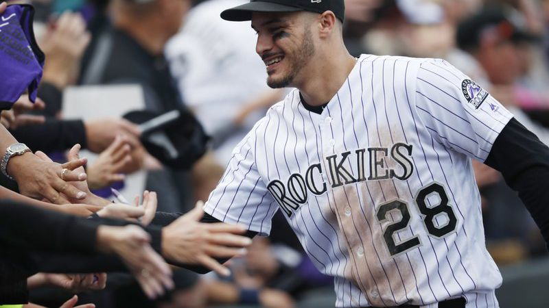 FILE - In this Sept. 30, 2018, file photo, fans congratulate Colorado Rockies third baseman...