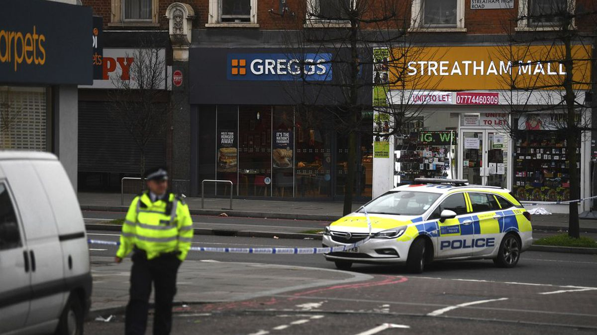 "Police attend the scene after an incident in Streatham, London, Sunday Feb. 2, 2020. London police say officers shot a man during a ""terrorism-related incident"" that involved the stabbings of ""a number of people."" (Victoria Jones/PA via AP)"