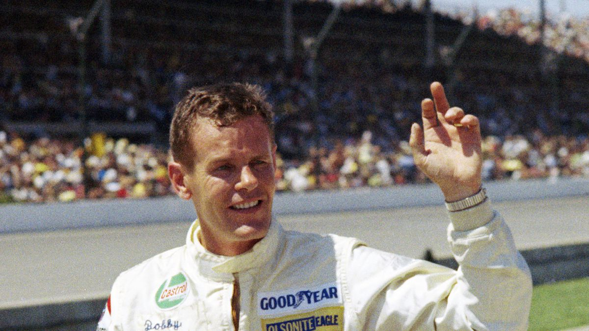 FILE - Auto racer Bobby Unser is shown at the Indianapolis 500 auto race in Indianapolis, Ind.,...