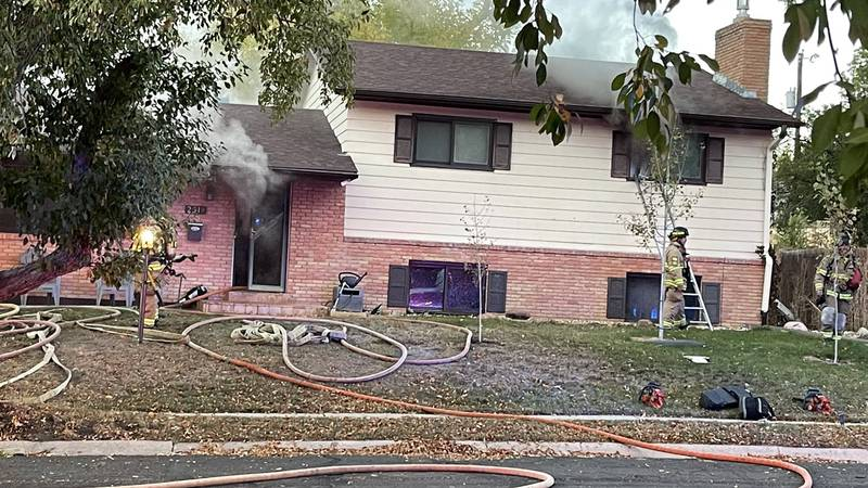 Firefighters work to put out house fire in Colorado Springs.