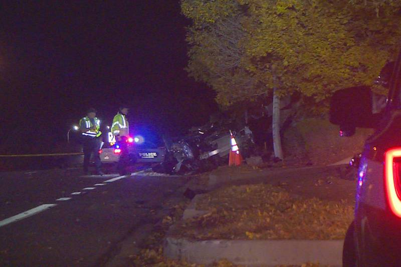 Police assess the scene of a crash in the 5000 block of Centennial Boulevard on Oct. 23, 2021,...