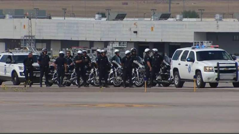 Police at DIA waiting for President Biden to arrive.
