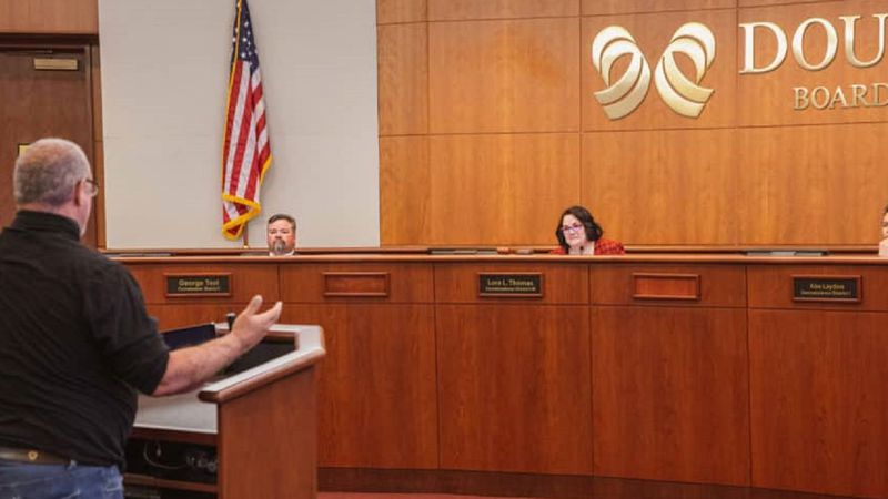 The Board of Douglas County Commissioners, George Teal, Lora Thomas, and Abe Laydon, listen to...