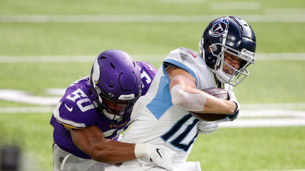 Tennessee Titans wide receiver Adam Humphries is tackled by Minnesota Vikings linebacker Eric Wilson (50) during the second half of an NFL football game, Sunday, Sept. 27, 2020, in Minneapolis. The NFL issued a statement Tuesday saying both the Titans and Minnesota Vikings suspended in-person activities Tuesday following the Titans' test results.
