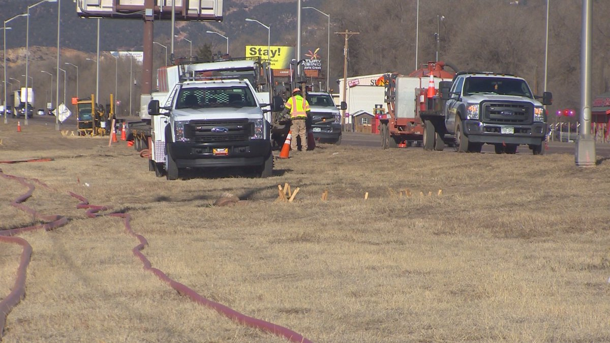 Colorado Department of Transportation crews install a fiber optic cable along Highway 24 on...
