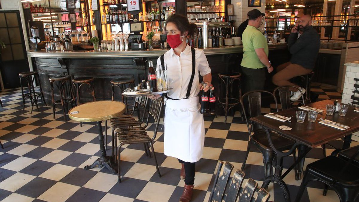 A waitress brings drinks to customers in a restaurant, Monday, June 15, 2020 in Paris. Paris...