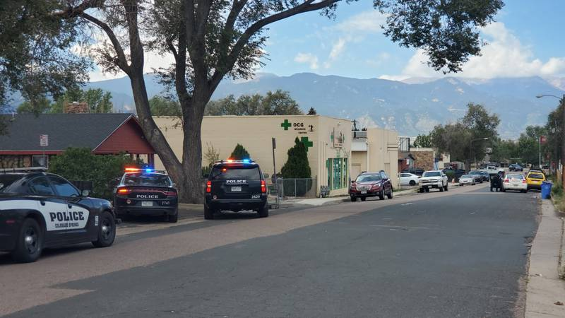 Police swarm St. Vrain Street, near where the suspect in two bank robberies was captured.