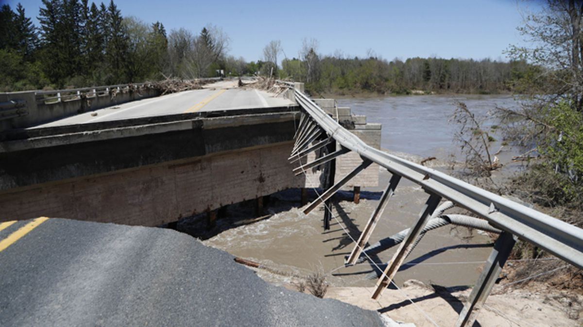 Damage is seen on one of two North M-30 bridges on Wednesday, May 20, 2020, in Edenville, Mich. After two days of heavy rain, the Edenville Dam failed and flood waters rushed south, ravaging the landscape in its path. (AP Photo/Carlos Osorio)