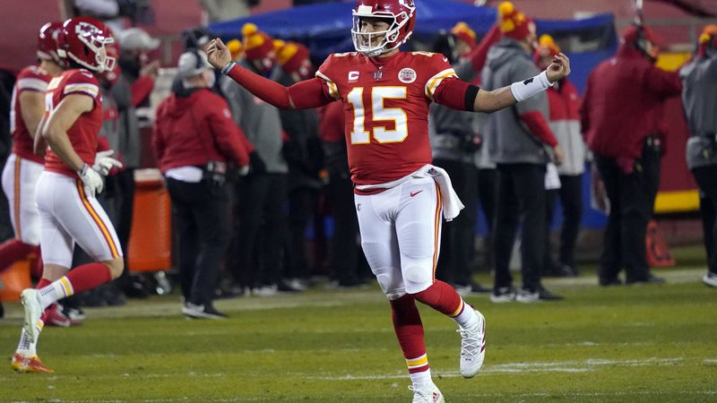 Kansas City Chiefs quarterback Patrick Mahomes celebrates after throwing a 5-yard touchdown...
