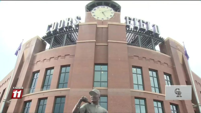 Rockies fans visit outside of Coors Field on Opening Day