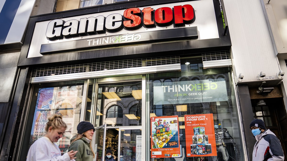FILE - In this Jan. 28, 2021 file photo, pedestrians pass a GameStop store on 14th Street at...