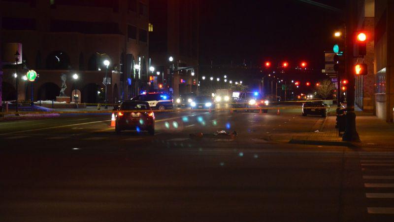 Police investigate the scene of a deadly car versus pedestrian collision in downtown Colorado...