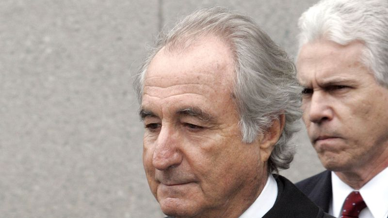 FILE - In this Tuesday, March 10, 2009, file photo, former financier Bernie Madoff exits...