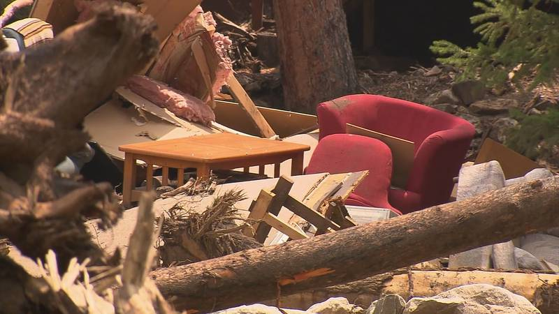 Furniture can be seen among the debris swept up by the swollen Poudre River in mid-July 2021.
