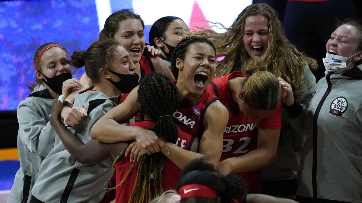 Arizona players celebrate after a women's Final Four NCAA college basketball tournament...