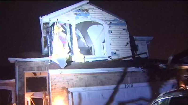 Tornado damage is seen in Naperville, Ill., early Monday morning