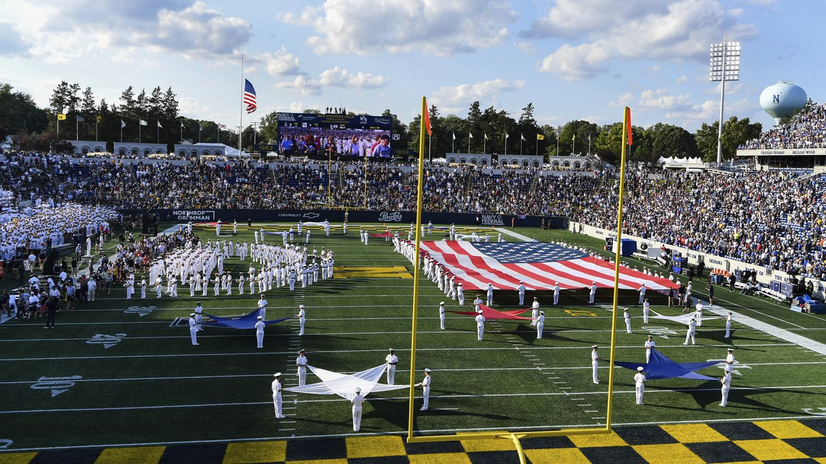 Navy's marching band performs at halftime during an NCAA college football game between Navy and...