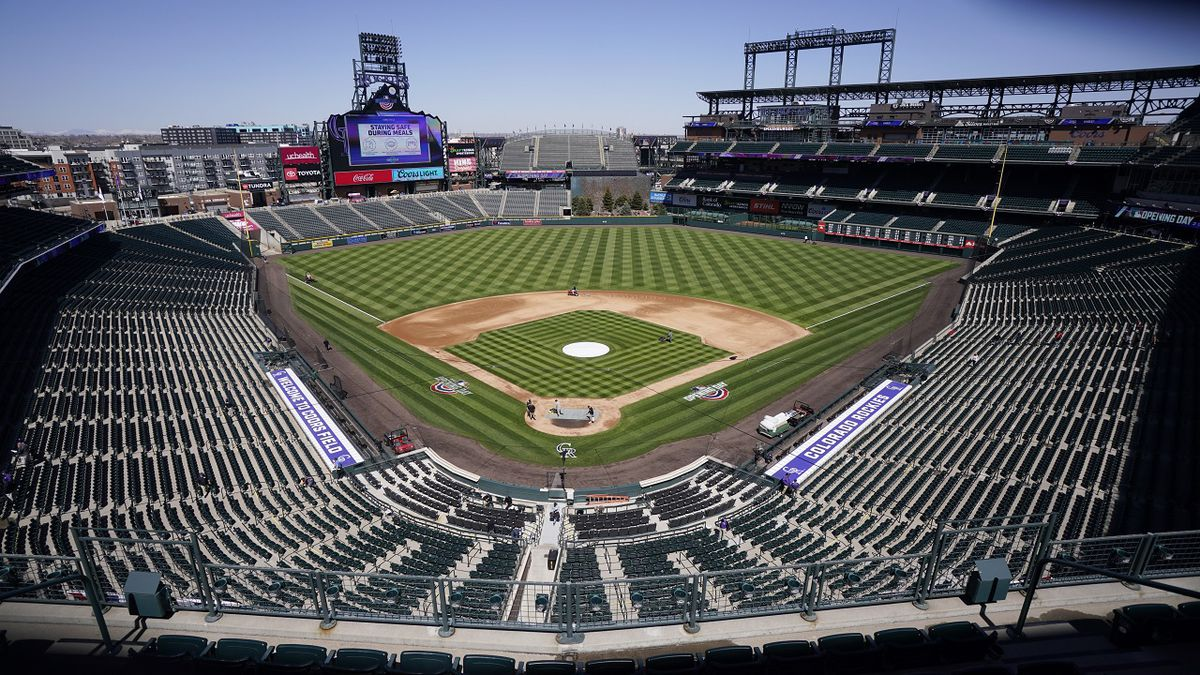 Workers prepare Coors Field on Wednesday, March 31, 2021, in Denver, the day before the...