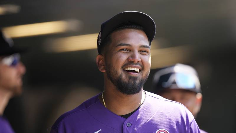 Colorado Rockies starting pitcher German Marquez jokes with teammates as word circulated in the...