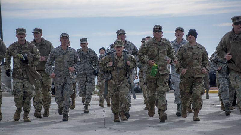 Colorado National Guard Sgt. Michaela Thomas (center), 220th Medical Police Company, arrives at...