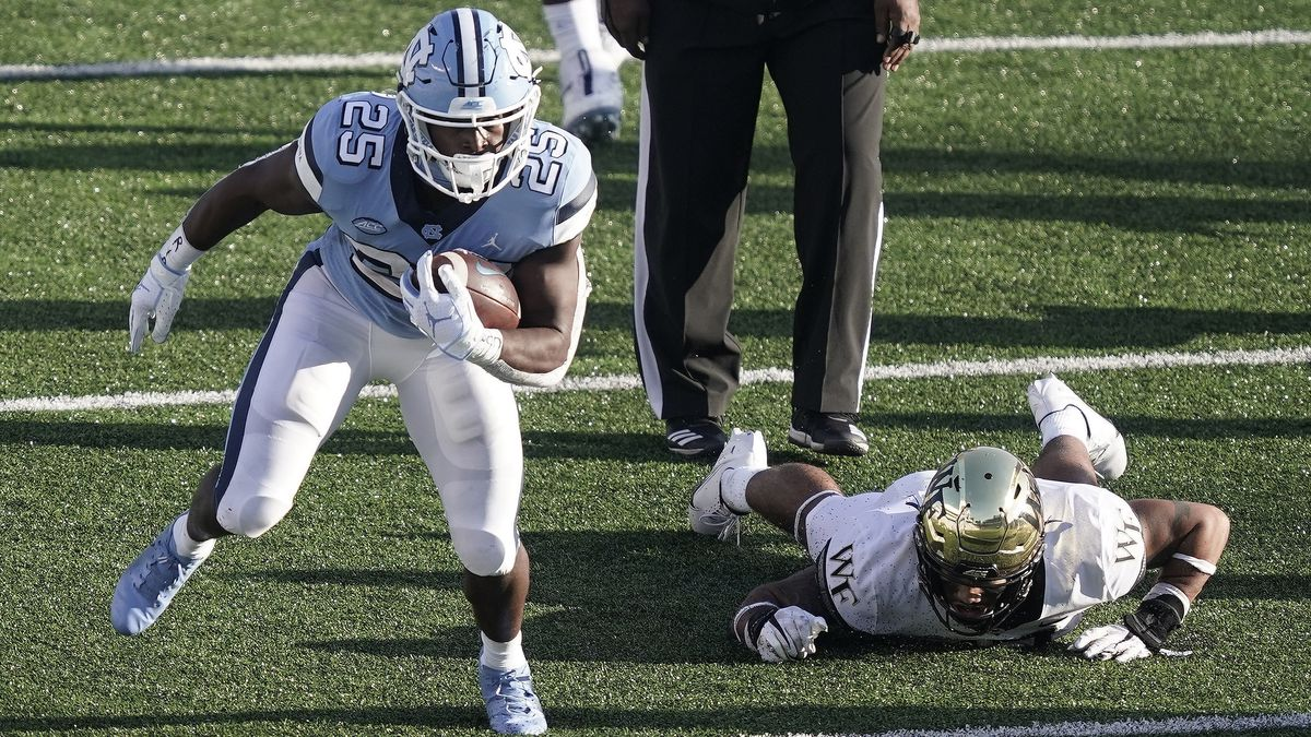 North Carolina running back Javonte Williams (25) finds some running room during the second...