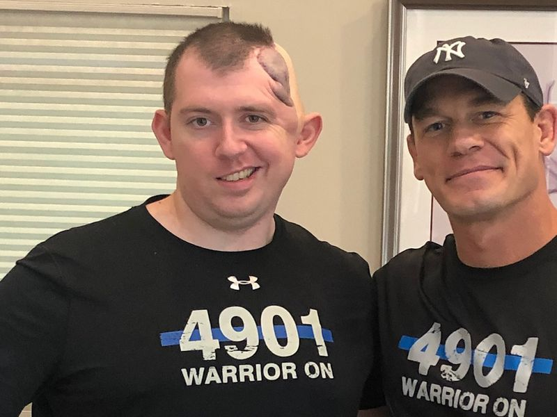 Officer Cem Duzel with the Colorado Springs Police Department met John Cena.  Photo courtesy...