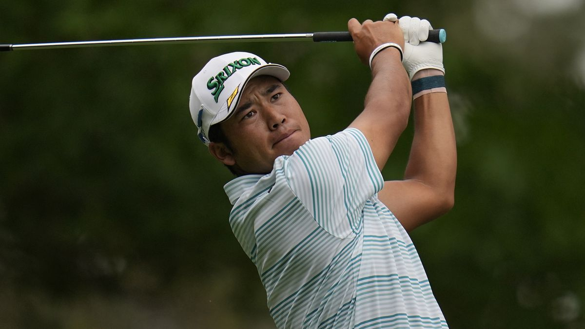 Hideki Matsuyama, of Japan, tees off on the fourth hole during the third round of the Masters...