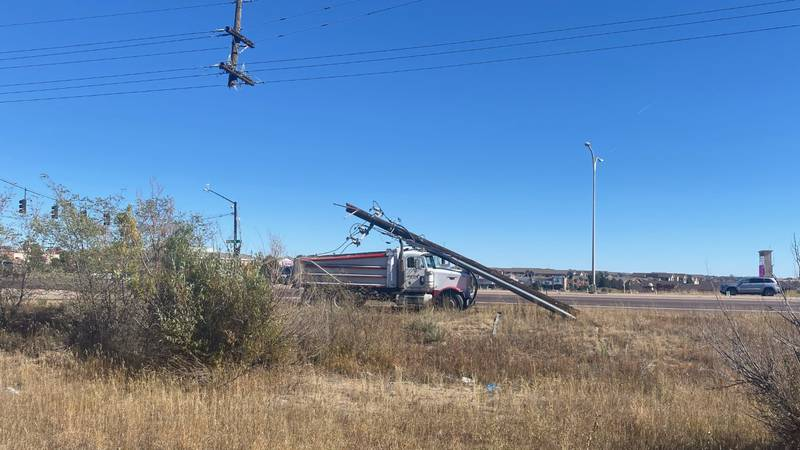 A trash truck completely dismantled a power pole at the scene of a crash at Powers and Stetson...